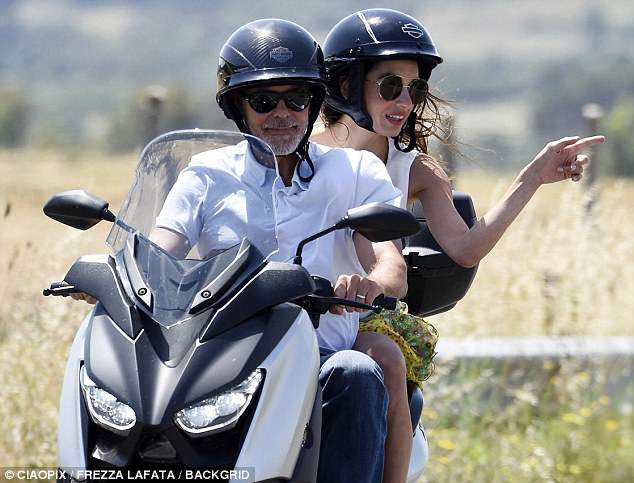 George and Amal cruising Sardinia on a motorbike 4CE8D47E00000578-0-image-m-105_1528141327033