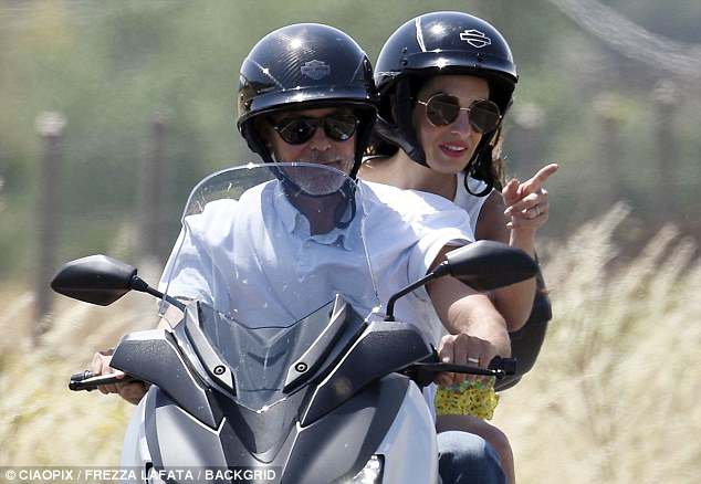 George and Amal cruising Sardinia on a motorbike 4CE8D5A900000578-0-image-m-124_1528141898596