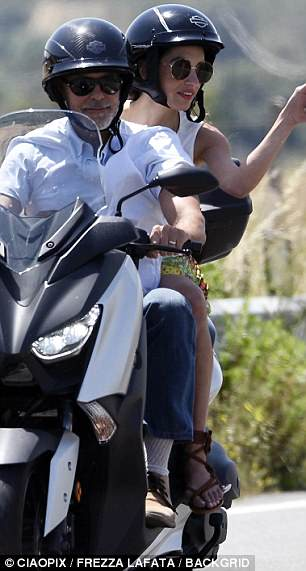George and Amal cruising Sardinia on a motorbike 4CE8D5C900000578-0-image-a-123_1528141766826