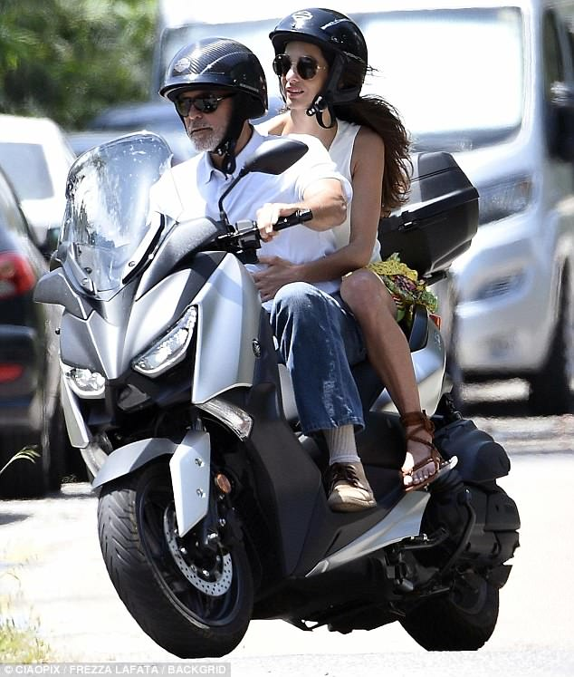 George and Amal cruising Sardinia on a motorbike 4CE8D7AB00000578-0-image-m-85_1528140168096