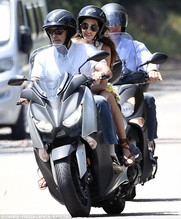 George and Amal cruising Sardinia on a motorbike 4CE8D7B400000578-0-image-m-104_1528141188361