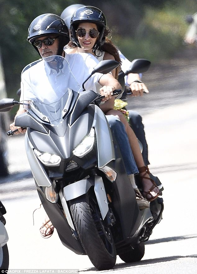George and Amal cruising Sardinia on a motorbike 4CE8D7B800000578-0-image-m-99_1528140961322