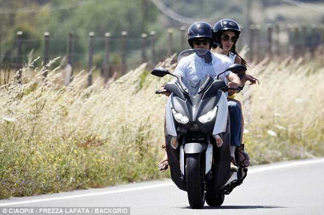 George and Amal cruising Sardinia on a motorbike 4CE8D62E00000578-5805221-Role_model_George_also_opened_up_about_how_he_ll_raise_his_child-a-134_1528142568264