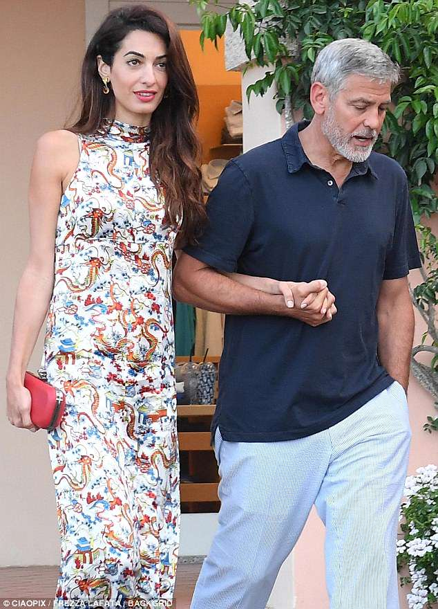 George and Amal out for dinner in Sardinia (2) 4CF6153300000578-5814585-Globetrotter_The_glamor_icon_was_born_in_Beirut_and_has_citizens-a-8_1528338699216