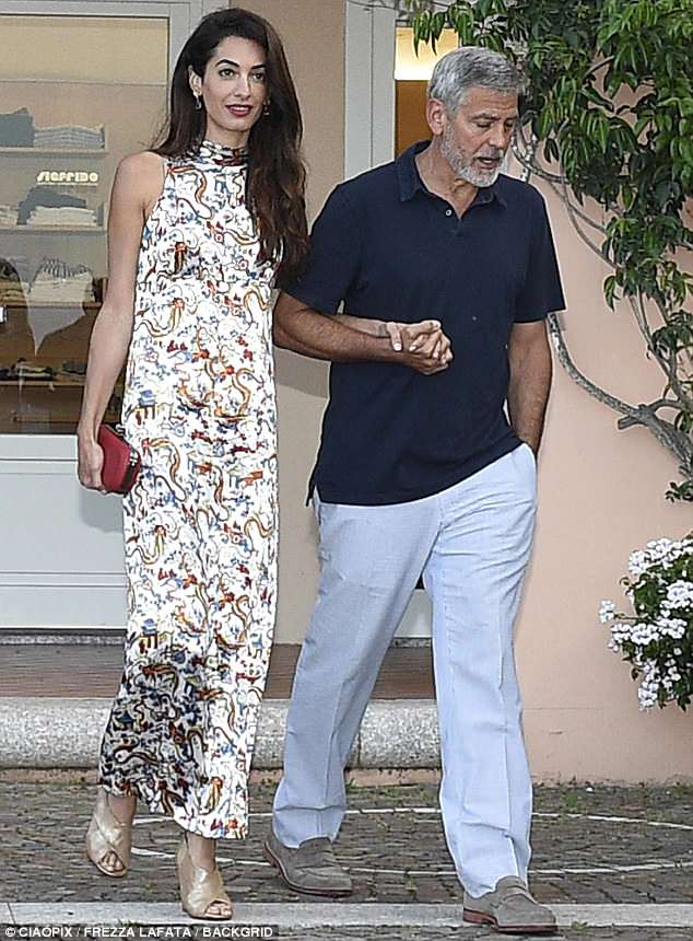 George and Amal out for dinner in Sardinia (2) 4CF62F4F00000578-5814585-Accenting_the_look_The_dress_was_hemmed_above_the_ankle_allowing-a-1_1528358723239