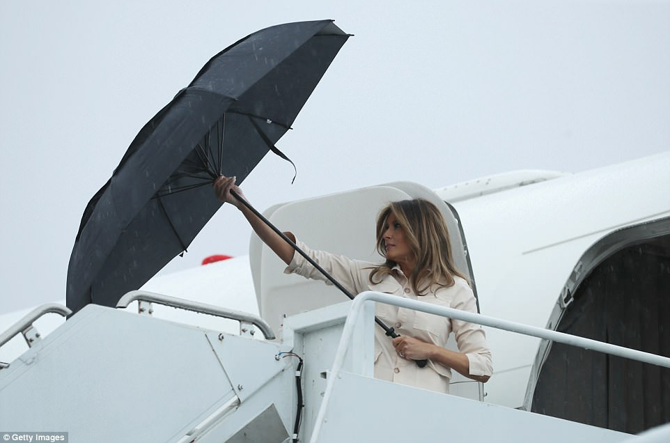 The Serious Side - part 6 - Page 10 4D7ED99000000578-5871221-Wet_arrival_The_first_lady_arrived_at_McAllen_airport_on_a_gover-a-211_1529618706956