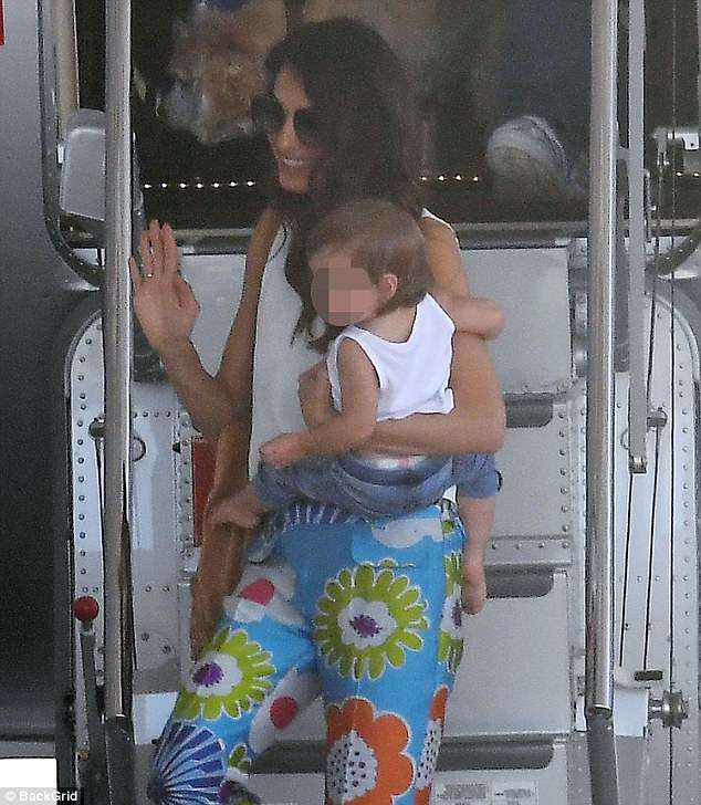 George and Amal Clooney arrive in Sardinia Today 4D96607400000578-5879923-With_her_little_girl_She_was_likely_holding_onto_Ella_who_was_dr-a-3_1529854911420