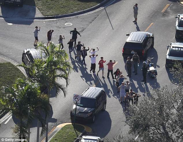 The Serious Side - part 6 - Page 11 4DAAA6EA00000578-5889889-People_are_brought_out_of_the_Marjory_Stoneman_Douglas_High_Scho-a-4_1530067053361