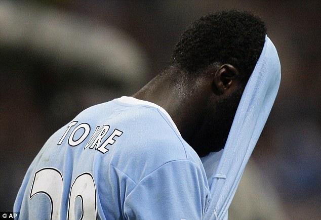 Kolo Toure fails drugs test. Citeh Suspend him.  Article-1362692-0972847E000005DC-828_634x435