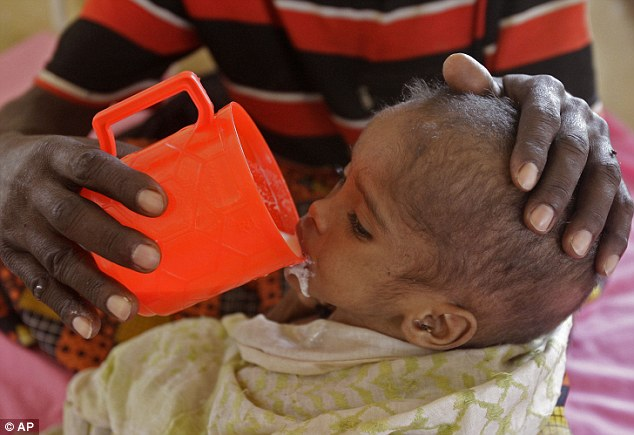 Ogathoa Somalia أغيثو الصومال (( للنشر For publication )) Article-2025054-0D40A3E600000578-54_634x435