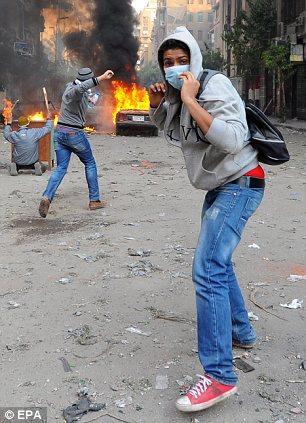 بالصور // The events of Tahrir Square on 19.20, 21, 22.23, 24 November أحداث ميدان التحرير يوم  19، 20 ، 21 ، 22 ، 23 ،24نوفمبر Article-2064674-0EE4697100000578-489_306x423