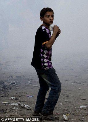 بالصور // The events of Tahrir Square on 19.20, 21, 22.23, 24 November أحداث ميدان التحرير يوم  19، 20 ، 21 ، 22 ، 23 ،24نوفمبر Article-2064674-0EE5F43F00000578-922_306x423