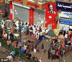 بالصور // The events of Tahrir Square on 19.20, 21, 22.23, 24 November أحداث ميدان التحرير يوم  19، 20 ، 21 ، 22 ، 23 ،24نوفمبر Article-2065194-0EEA024200000578-460_306x261