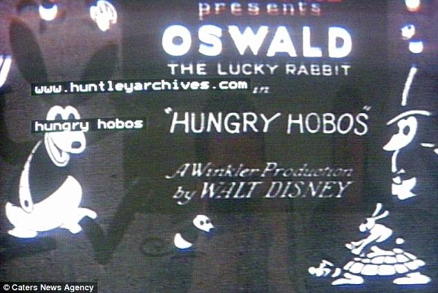 [Cartoon Walt Disney] Oswald le Lapin Chanceux : Hungry Hobos Article-2067148-0EF89EBE00000578-122_634x425
