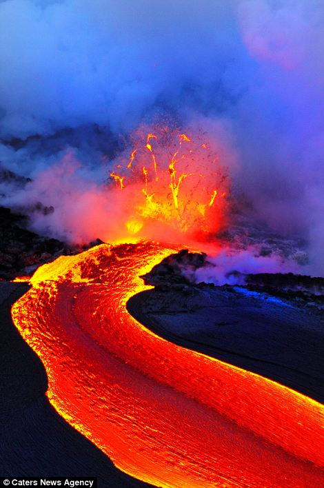 """""""Photographers brave boiling waters to capture the drama of ... lava crashing into the sea off Hawaii""""  Article-2198591-14D878BF000005DC-179_470x708"""