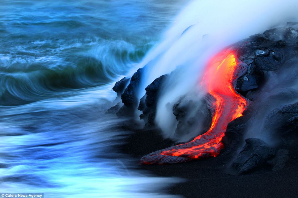 """""""Photographers brave boiling waters to capture the drama of ... lava crashing into the sea off Hawaii""""  Article-2198591-14D87A2E000005DC-258_964x641"""