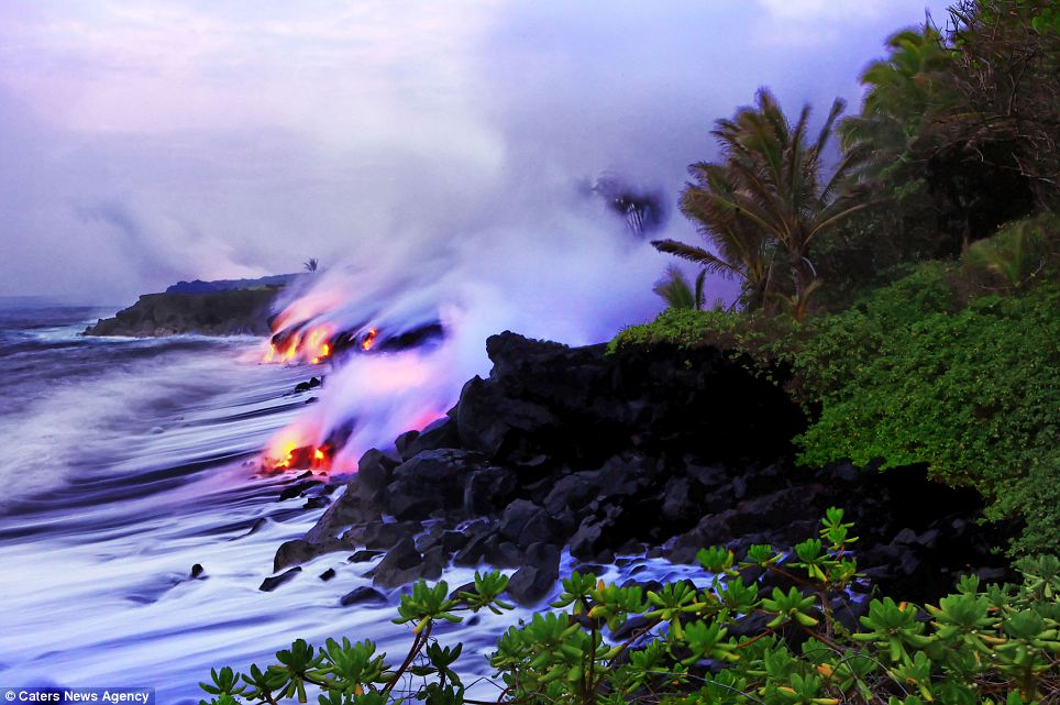 """Photographers brave boiling waters to capture the drama of ... lava crashing into the sea off Hawaii""  Article-2198591-14D87A37000005DC-519_964x641"