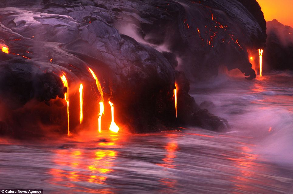 """Photographers brave boiling waters to capture the drama of ... lava crashing into the sea off Hawaii""  Article-2198591-14D87B6E000005DC-142_964x641"