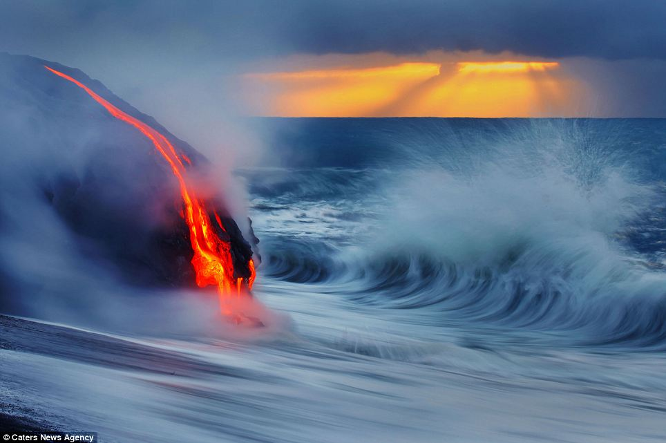"""Photographers brave boiling waters to capture the drama of ... lava crashing into the sea off Hawaii""  Article-2198591-14D87B9E000005DC-632_964x641"