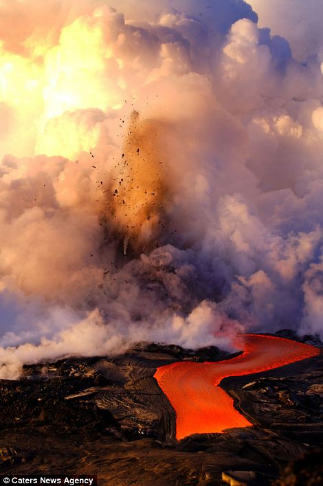 """Photographers brave boiling waters to capture the drama of ... lava crashing into the sea off Hawaii""  Article-2198591-14D87C89000005DC-138_470x708"