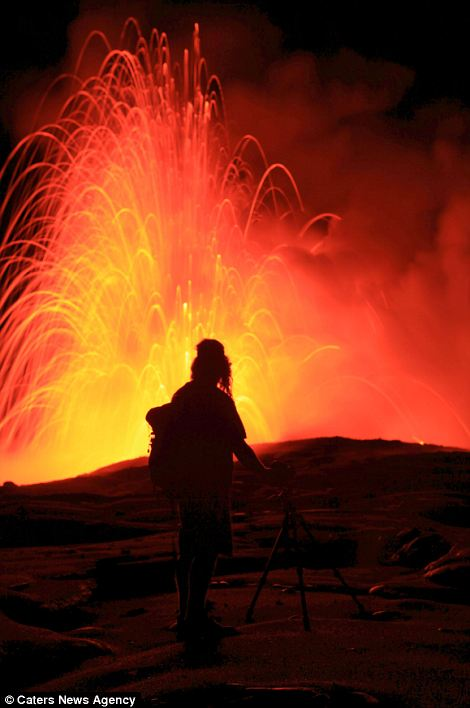 """""""Photographers brave boiling waters to capture the drama of ... lava crashing into the sea off Hawaii""""  Article-2198591-14D87DA8000005DC-825_470x708"""