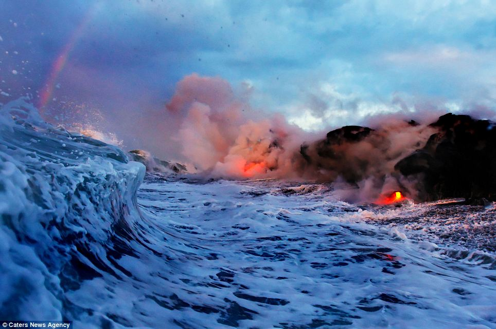 """Photographers brave boiling waters to capture the drama of ... lava crashing into the sea off Hawaii""  Article-2198591-14D8812B000005DC-696_964x641"