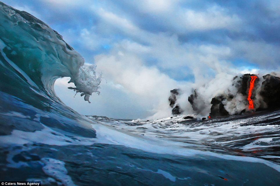 """""""Photographers brave boiling waters to capture the drama of ... lava crashing into the sea off Hawaii""""  Article-2198591-14D8829B000005DC-872_964x641"""