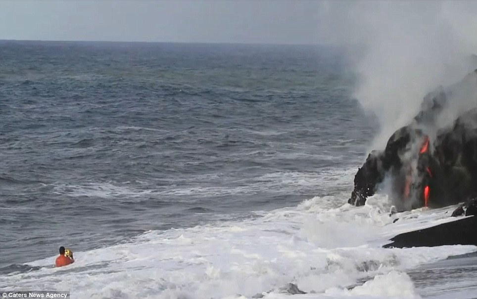 """""""Photographers brave boiling waters to capture the drama of ... lava crashing into the sea off Hawaii""""  Article-2198591-14D88679000005DC-621_964x605"""