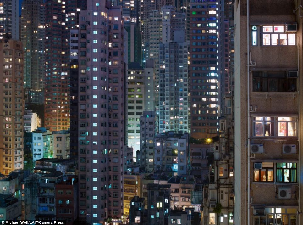 Crowded: Earlier this year the Hong Kong-based Society for Community Organisation highlighted the plight of the city's poorest families, many of whom are forced to live in almost inconceivably small spaces