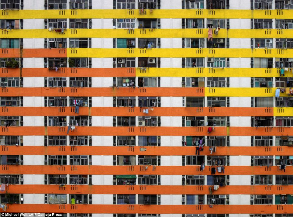 Higgledy-piggledy: More cramped living quarters piled several stories high in this close-up shot of a high rise apartment building in Hong Kong