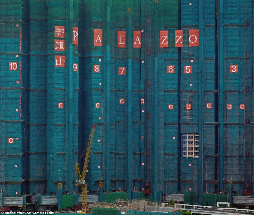 Construction: The photographer has documented more building work underway in Hong Kong as the city struggles to find space for its already cramped population
