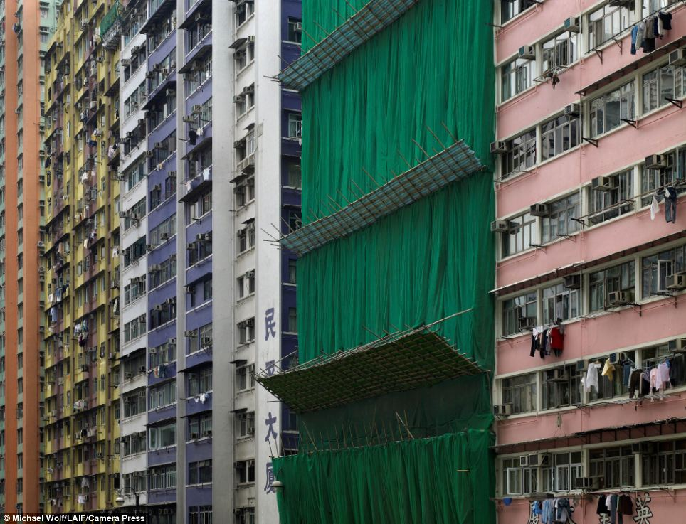 Over-population: These photographs of Hong Kong's apartment buildings appear to reflect a city bursting at the seams