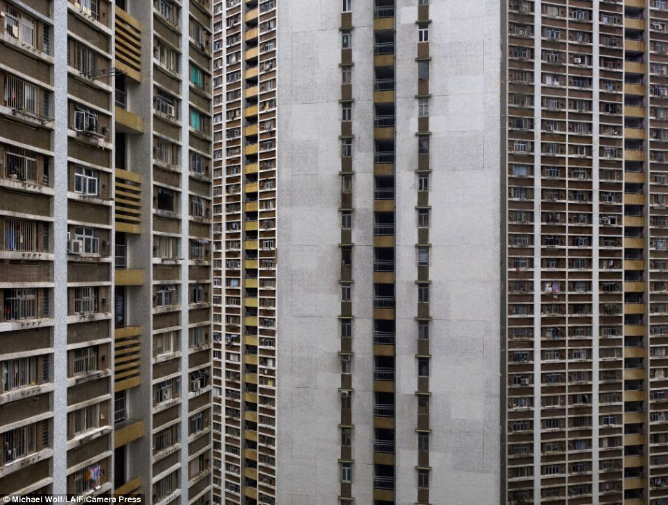 Grid: Seemingly endless windows and balconies in a another close-up of a Hong Kong apartment building