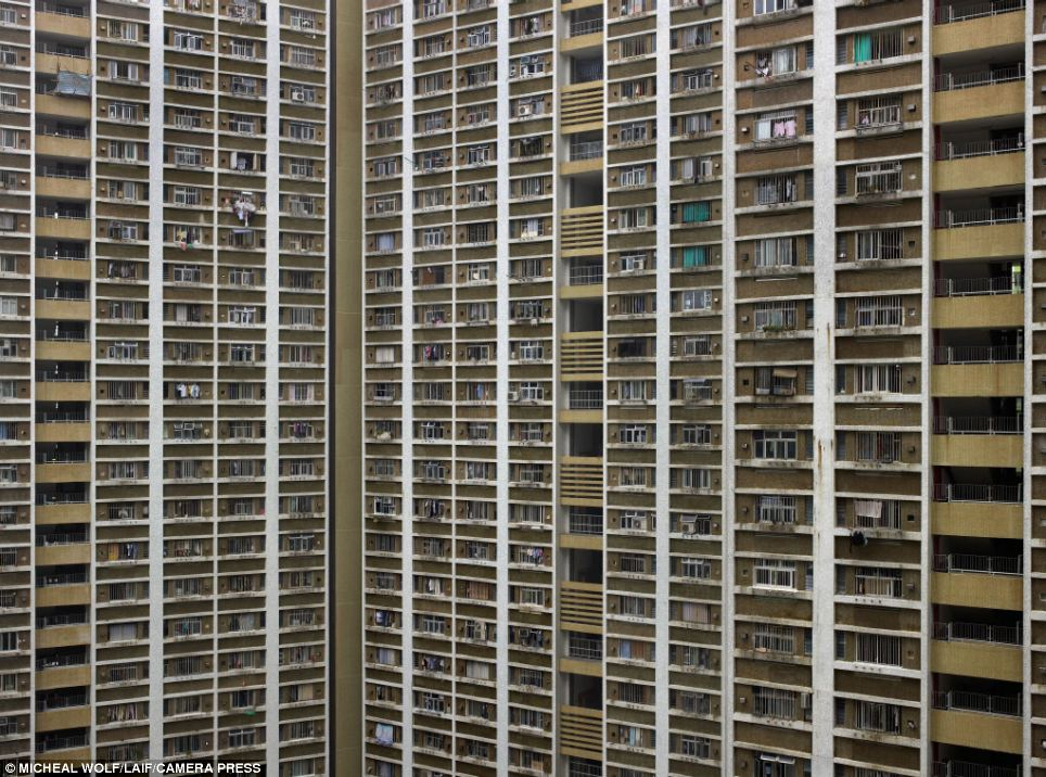 Scale: Michael Wolf's photographs make the number of living spaces piled one on top of the other in this Hong Kong skyscraper seem never-ending