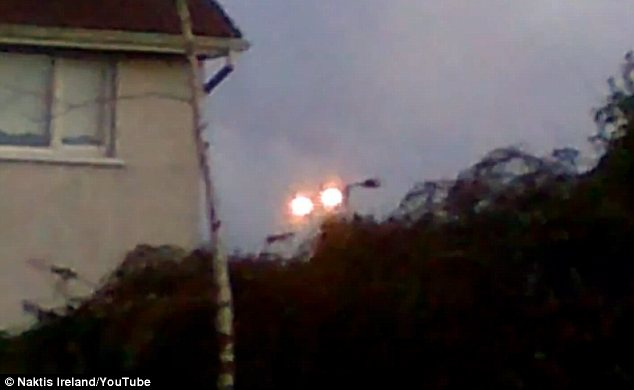Have aliens landed in Ireland? 'UFO spotter' posts mysterious video of glowing fireballs floating  Article-0-196DD27F000005DC-869_634x390