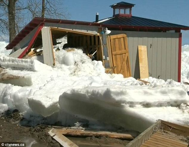 Massive wall of ice rises out of lake and destroys a dozen homes as residents watch helplessly from the shore  Article-0-19BDA853000005DC-605_634x494