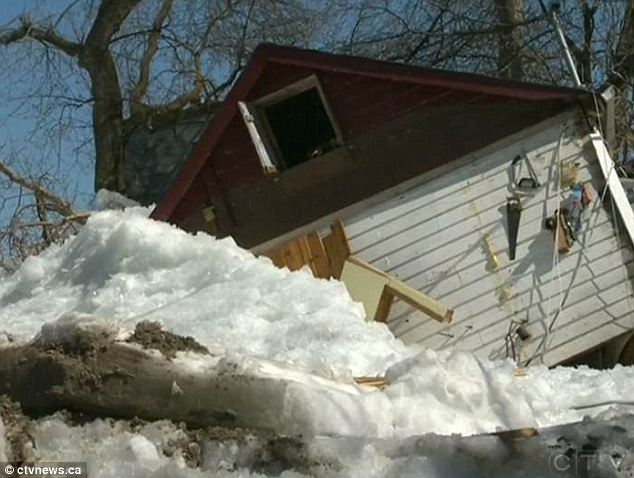 Massive wall of ice rises out of lake and destroys a dozen homes as residents watch helplessly from the shore  Article-0-19BDA875000005DC-773_634x478