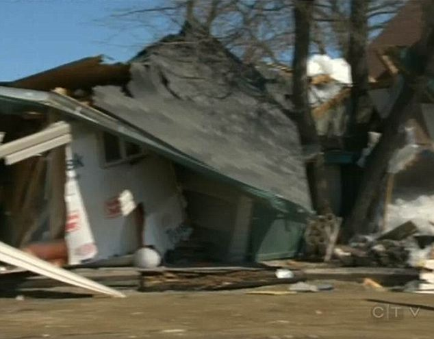 Massive wall of ice rises out of lake and destroys a dozen homes as residents watch helplessly from the shore  Article-0-19BDA885000005DC-281_634x495