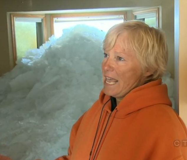 Massive wall of ice rises out of lake and destroys a dozen homes as residents watch helplessly from the shore  Article-0-19BDA8A2000005DC-911_634x543