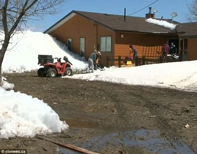 Massive wall of ice rises out of lake and destroys a dozen homes as residents watch helplessly from the shore  Article-0-19BDA8A9000005DC-126_634x495
