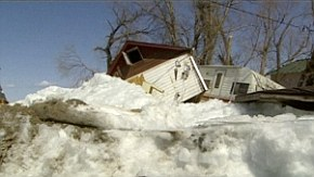 Massive wall of ice rises out of lake and destroys a dozen homes as residents watch helplessly from the shore  Video-undefined-19BED50E000005DC-416_290x163