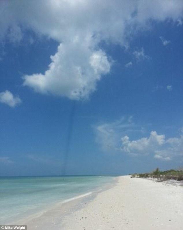 Mysterious Dark Line Shoots From Cloud at Honeymoon Beach Florida Article-0-1B22DF61000005DC-219_634x796