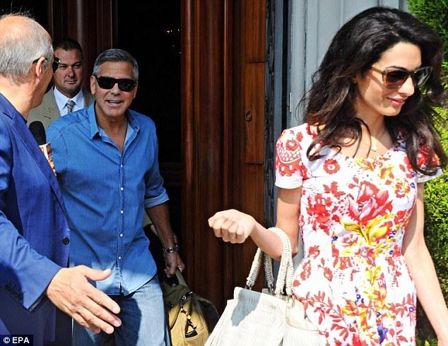 George Clooney leaving Florence Article-2748212-212DE6B800000578-531_634x490