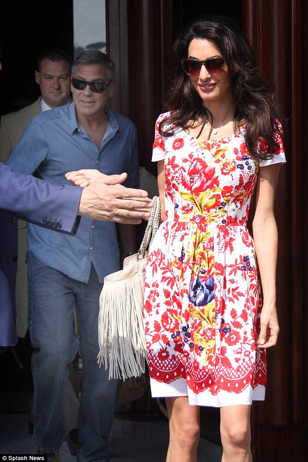 George Clooney leaving Florence Article-2748212-212F974D00000578-517_634x952