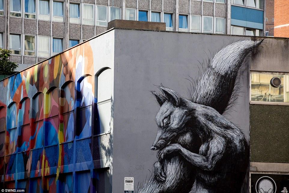 Grafiti - ulična umetnost 1412852907360_wps_78_An_animal_artwork_mural_b