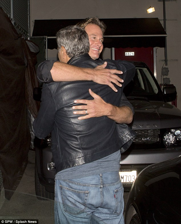 George Clooney out at Saturday night in Hollywood 1413756563473_wps_32_George_Clooney_and_his_go