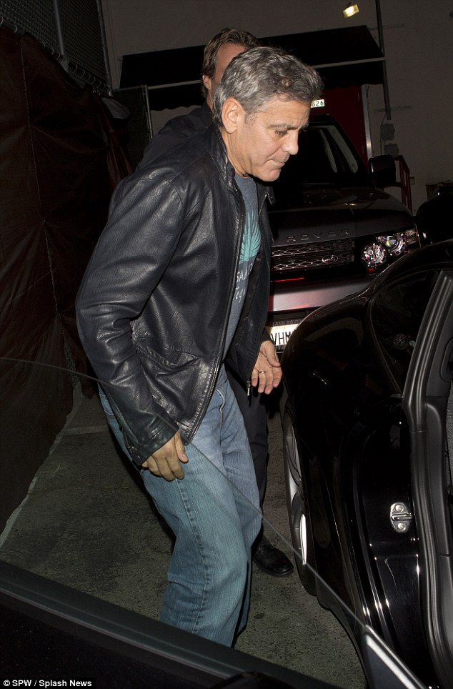 George Clooney out at Saturday night in Hollywood 1413757007125_wps_34_George_Clooney_and_his_go