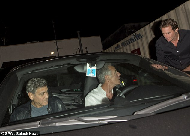 George Clooney out at Saturday night in Hollywood 1413757472123_wps_46_George_Clooney_and_his_go