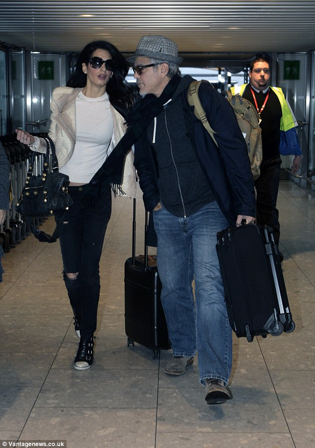 George and Amal Clooney spotted at Heathrow 238BC2BE00000578-2851739-image-62_1417093445660