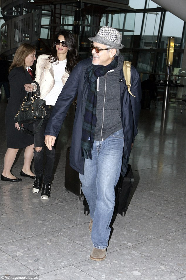 George and Amal Clooney spotted at Heathrow 238BC8CE00000578-0-image-58_1417092621687